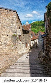Narrow ancient Street in Besancon in Bourgogne Franche Comte region in France.