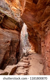 Narrow area of a slot Canyon in southwestern USA.  Erosion and weather have sculpted the orange and brown walls and floor.  Echo Canyon, Zion National Park, Utah USA