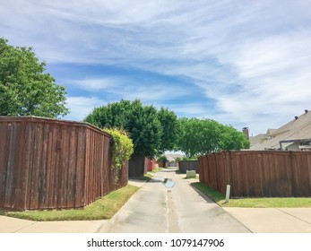 Narrow Back Alley At Suburban Neighborhood In Irving, Texas, USA. Small  Concrete Pathway