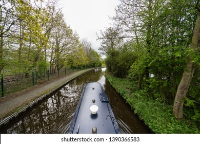 Narrow boat (barge) cruising along the Llangollen Canal connecting England and Wales, United Kingdom