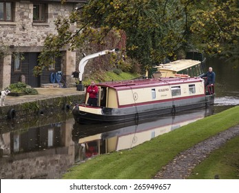 narrow boat barges maneouvreing near a bridge near Llanfoist wharf,on the Monmouthsire and Brecon Canal,Wales.taken 15/10/2014