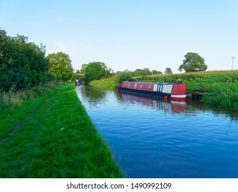 A narrow boat moored on the banks of the Shropshire Union Canal, near Whitchurch.