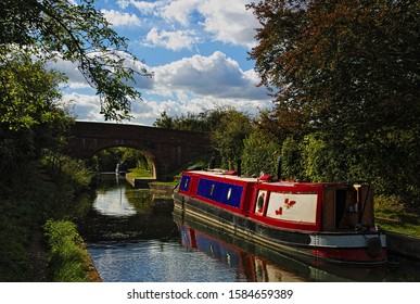 Narrow boats along the Wendover Arm Canal, near the town of Tring, in the county of Hertfordshire, England, on a sunny summers day.
