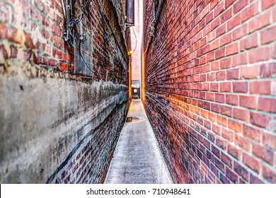 Narrow Brick alley in Georgetown, Washington DC with vintage grunge look and illuminated lights