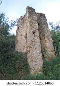 Narrow brick ruin on steep hill in Andalusian countryside, Spain