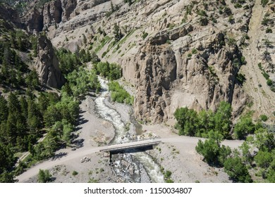 Narrow bridge cross a river in the mountains of western Wyoming.