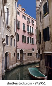 A narrow canal lined with homes in Venice.