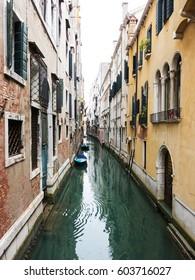 A narrow canal in Venice, Italy