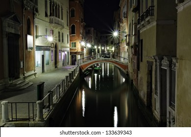 Narrow canal in Venice at night Italy