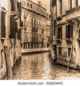 narrow canal in Venice in sepia tone, Italy