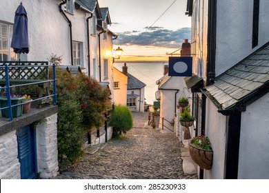 Narrow cobbled streets lined with cottages on a steep hill at Clovelly on the Devon coast