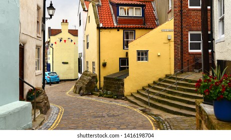 Narrow cobbled village street scene