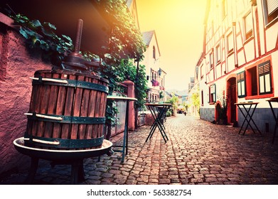 Narrow cobblestone street in old town at summertime. Cityscape Alsace, France