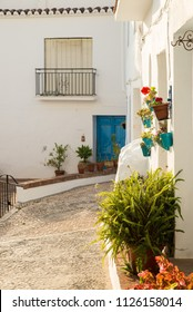 Narrow cobblestoned old town street in Frigiliana, Malaga, Andalusia, Spain.