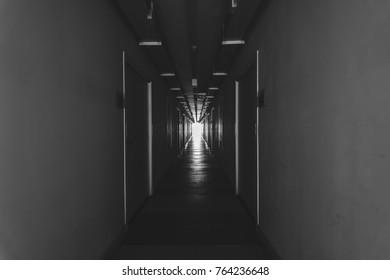 Narrow corridor inside the building. Black and white photos.