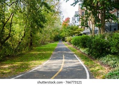 Narrow Cycle Path Lined with Trees on a Sunny Early Autumn Day. Alexandria, VA.