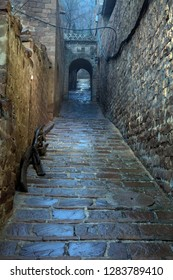 A narrow, damp alley, China