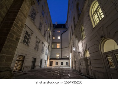Narrow and dark medieval courtyard in the schweizerhof aisle of the Hofburg palace in Vienna, the former imperial castle residence of the Habsburg dynasty in the Austro Hungarian Empire