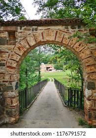 Narrow Entrance Through Gate and Narrow Bridge To Ancient Monastery and