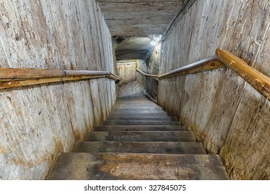 Narrow entrance wooden stairs in an old salt mine