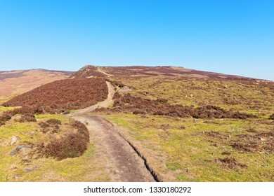 A narrow footpath winds gently up Derwent Moor in the Derbyshire Peak District.