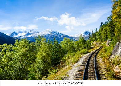 The narrow gauge rails of the historic White Pass & Yukon Route Railroad, built in 1898 for prospectors during the Klondike Gold Rush, links the port of Skagway, Alaska with Whitehorse, Yukon.
