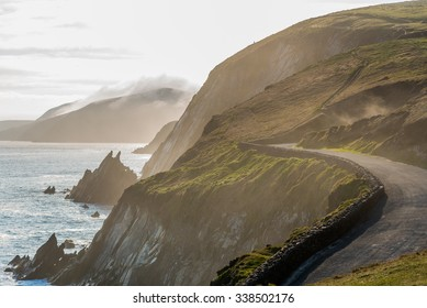 Narrow Irish coastal road in spring evening, just above the steep and dangerous cliffs.