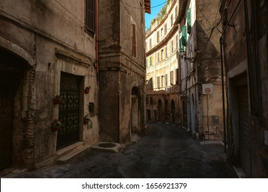 Narrow italian street in the center of Rome on a sunny day. Old street in Rome, Italy. Usual life in Rome. Summer in Mediterranean city.
