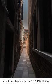 Narrow lanes of Venice, famous narrow streets of Venezia, world heritage destination in Italy.