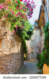 narrow medieval small town street of Provence at summer day, France