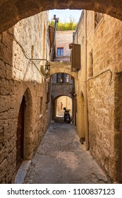 Narrow medieval street of old town in City of Rhodes (Rhodes, Greece)