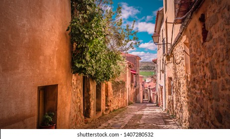 Narrow medieval streets in Siguenza, Guadalajara province in Spain near Madrid. Beautiful, old and medieval city of Siguenza in Castilla-la-Mancha region.