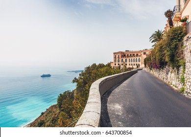 Narrow mountain road leading to Taormina, Sicily hugging the coastline overlooking the bay of Giardini Naxos in Sicily
