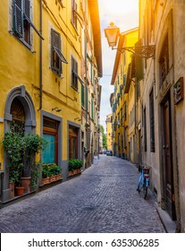Narrow old cozy street in Lucca, Italy. Lucca is a city and comune in Tuscany. It is the capital of the Province of Lucca