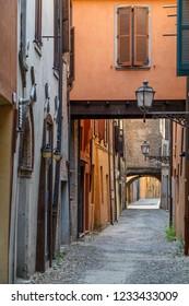 Narrow old street in the historic centre of Ferrara, Italy