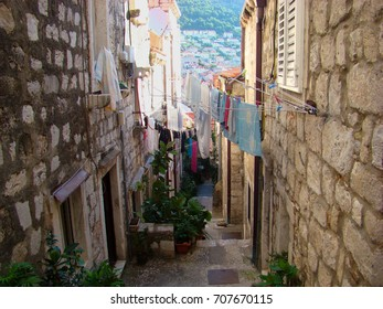 Narrow old street with stones houses in Dubrovnik, Croatia