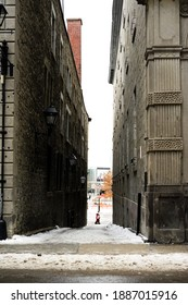 Narrow, one way street in downtown of Montreal, Canada. Big concrete buildings.