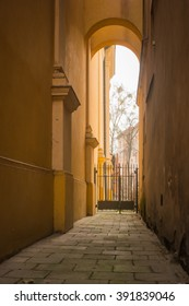Narrow passage between buildings in Warsaw, Poland