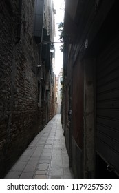 Narrow passageway between buildings in Venice, Italy