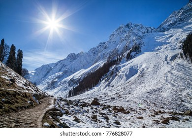A narrow pathway leading to Himalayan Mountains near Sonmarg, Jammu and Kashmir, India