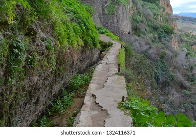 Narrow pathway on the hiking trail at El Tajo Gorge enroute to the water mine, Ronda, Spain