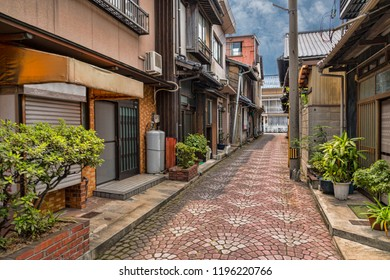 Narrow Pedestrian Street in Historic Town Center of Traditional Japanese Town. Blue Sky, No People. (Tomonoura, Hiroshima Prefecture, Japan).