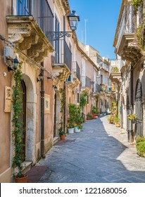 A narrow and picturesque road in Ortigia, Siracusa old town, Sicily, southern Italy. July-09-2018