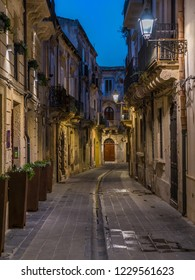 A narrow and picturesque road in Ortigia, Siracusa old town, Sicily, southern Italy.