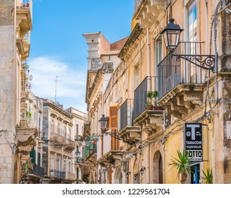 A narrow and picturesque road in Ortigia, Siracusa old town, Sicily, southern Italy. July-25-2018