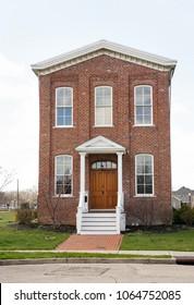 Narrow Red Brick House with Wooden Door