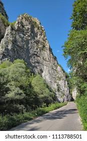 narrow road crosses Jerma Canyon in Vlaska Mountain, Serbia