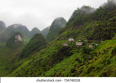 Narrow roads wind through the limestone and granite mountains of Ha Giang, Vietnam.
