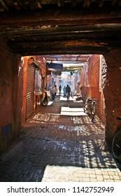 Narrow and shady alley of the medina of Marrakech.