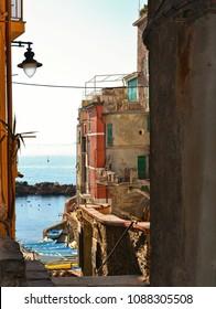 narrow small street and balcony on mediterranean sea  in old village Riomaggiore in Cinque Terre, Liguria Italy